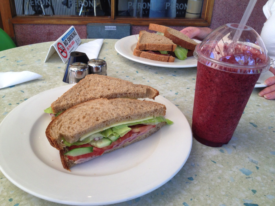 Salad sandwich and berry smoothie